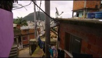 Slow motion tracking shot of apartments in a favela in Rio de Janeiro, Brazil