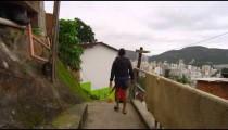 Slow dolly shot of walking kids in a favela on June 23, 2013 in Rio de Janeiro, Brazil