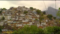 Slow tracking shot of a favela on a hill in Rio de Janeiro Brazil