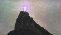 Sped-up night shot of Christ the Redeemer in Rio de Janeiro, Brazil.
