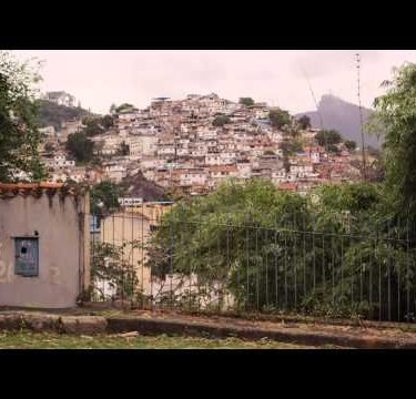 Slight tracking from left to right of favela in the heart of Brazil