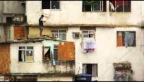 RIO DE JANEIRO, BRAZIL - JUNE 23: Man on a rooftop and girl in window in Rio de Janeiro, 2013