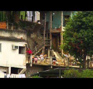 RIO DE JANEIRO, BRAZIL - JUNE 23: Slow-mo of kids playing outside in a favela Rio de Janeiro, 2013
