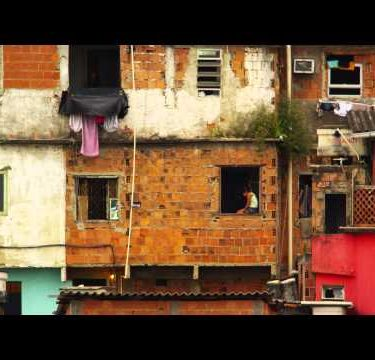 RIO DE JANEIRO, BRAZIL - JUNE 23: Slowmo of child in window sill in favela of Rio de Janeiro, 2013