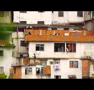 RIO DE JANEIRO, BRAZIL - JUNE 23: Slow motion of people on rooftops in favela Rio de Janeiro, 2013