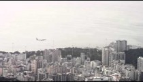 Pan of an airliner flying over Rio de Janeiro.