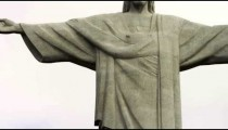 Pan of the statue of Christ atop Corcovado Mountain