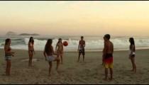 A group of teens playing soccer (football) on Ipanema beach