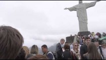 Slow motion panning footage of tourists at Rio's Christ statue