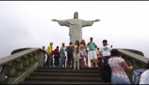 Slow motion tilt of tourists at the statue of Christ, Rio