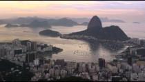 Pink sunset pan over Rio de Janeiro's cityscape