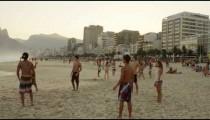 RIO DE JANEIRO-JUNE 16: Teen bicycle-kicks a football at beach on June 16, 2013 in Rio de Janeiro.