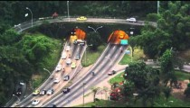 Morning still shot of the fast traffic at a tunneled intersection in Rio de Janeiro.