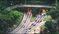 High-angle shot of traffic entering and exiting tunnels