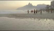 RIO DE JANEIRO-JUNE16: Teens kick a football at Ipanema beach on June 16, 2013 in Rio de Janeiro.