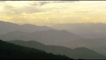 Different levels of hills rise under the morning sky in Rio de Janeiro