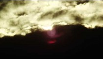 lens flares over the mountains behind a cloudy sky in Rio de Janeiro