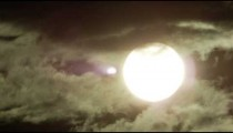 Still shot of the sun behind rolling storm clouds in Rio de Janeiro