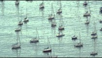 Slow-motion pan shot of boats sitting in the water near Avenida Portugal
