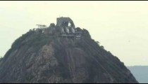 Static shot of a cable car going up Sugarloaf mountain in Rio De Janeiro