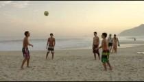 RIO DE JANEIRO-JUNE16: Teens kicking a football at the beach on June 16, 2013 in Rio de Janeiro.