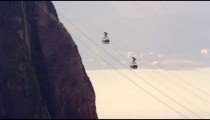 Static shot of cable cars going in opposite directions on Sugarloaf mountain in Rio De Janeiro