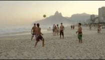 RIO DE JANEIRO-JUNE16: Boys kicking a football at the beach on June 16, 2013 in Rio de Janeiro.