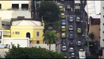 Looking down at cars moving across Rio intersection