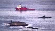 Barge and submarine in Guanabara Bay