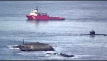 Barge and submarine moving through Guanabara Bay