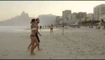 RIO DE JANEIRO-JUNE 16: People walking on Ipanema beach on June 16, 2013, in Rio de Janeiro.