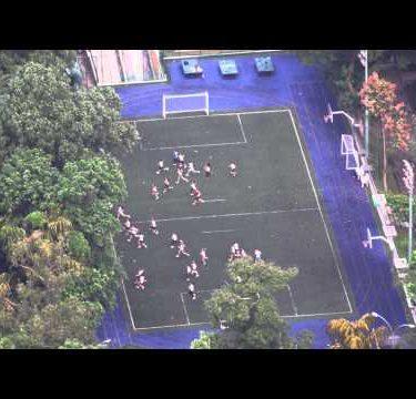 Bird's eye footage of people sprinting across football field