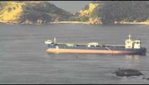 Barge slowly moving across Guanabara Bay