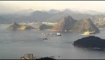Pan of barge moving across Guanabara Bay