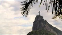 Pan of cloudy Rio sky and Christ statue