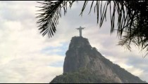 Pan of Christ statue and Corcovado on cloudy day