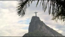 Slow pan of Christ statue and Corcovado on cloudy day