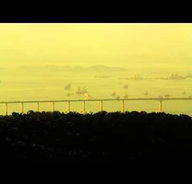 Long shot panning footage of Rio-Niteroi Bridge