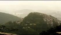 Tilting footage of Rio hills, homes, Maracan