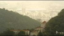 Pan footage of hills and houses of Rio, Maracan