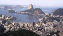 Pan of Rio and ocean from Corcovado lookout point