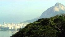Pan of Rio and surrounding mountains from lookout