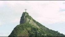 Slow pan of Christ statue and mountain