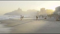 People enjoying Ipanema beach at dusk