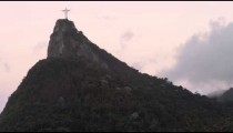 Panning shot of Christ statue on top of Corcovado in Rio de Janeiro, Brazil