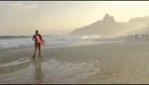 Woman runs while holding bodyboard