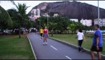 RIO-JUNE 18: People rollerbla bike, and walk along lake Lagoa at dusk on June 18, 2013 in Rio.