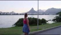 RIO-JUNE 18: Couple rollerblades, skateboards alongside Lagoa on June 18, 2013 in Rio de Janeiro.