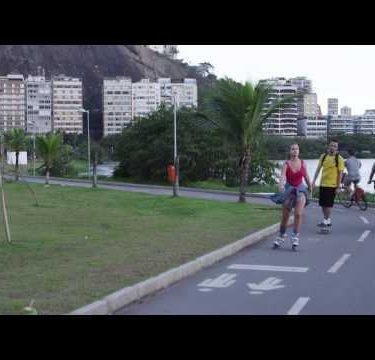 RIO - JUNE 18: People skate, bike, walk path near Lagoa on June 18, 2013 in Rio de janeiro.