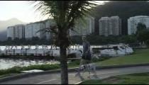 Man walks dog near Rio's lagoon